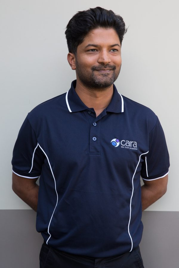 Image displays a Cara staff member wearing a Navy polo shirt with Cara logo