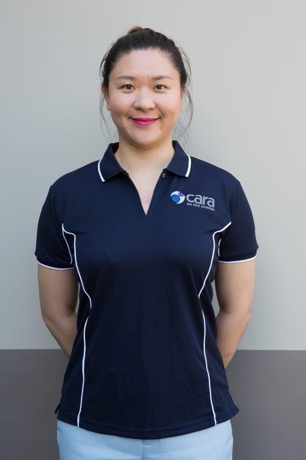 Image displays a Cara staff member wearing a Navy polo shirt with Cara logo